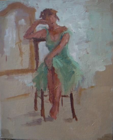 Sitting model in green dress
