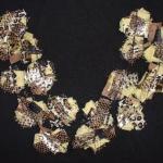 textiel ketting van 'tijger'stofjes