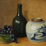 Fles, gemberpot en druiven