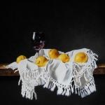 Stilleven met citroenen en wijnglas