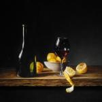 Stilleven met wijnglas en fles