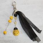 Sleutelhanger lieveheersbeestje geel/zwart