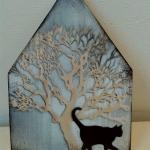 Huis met boom 3d en zwarte kat