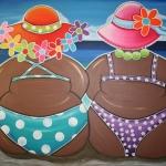 Dikke dames op het strand
