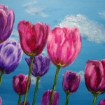 Coloured tulips in the blue sky